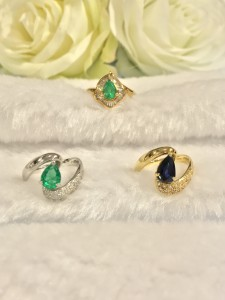 Top: K18YG 0.66ct Emerald Ring Bottom From Left: PT900 0.91ct Emerald Ring, K18YG 1.36ct Sapphire Ring