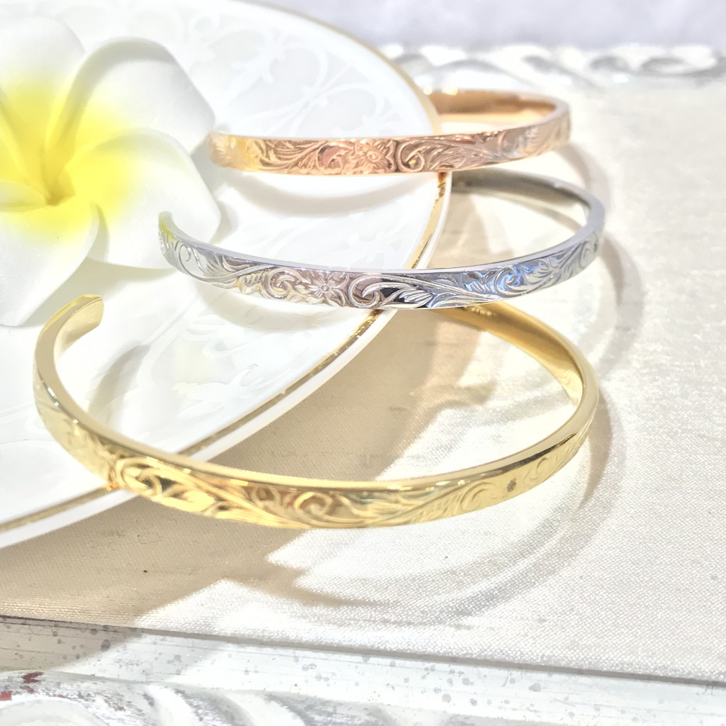 Bangles carved with Hawaiian Motifs, available in Rose Gold and Yellow Gold